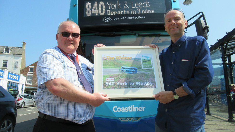 Paul Kirby (right) presents the award to Transdev's Colin Booth