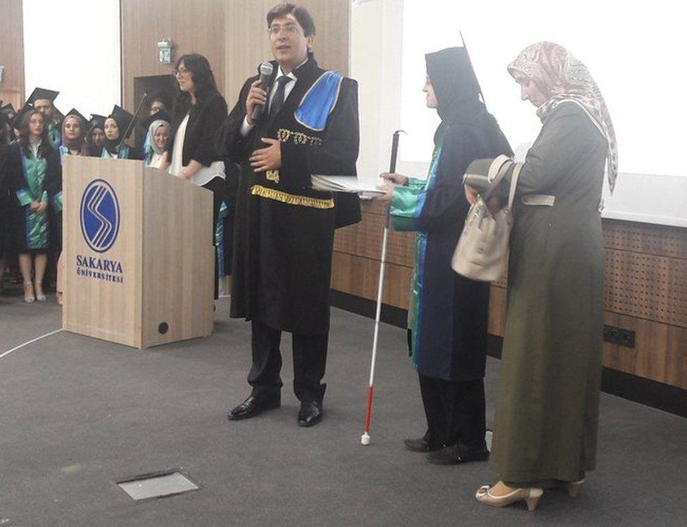 Sakarya University Law Faculty's Dean Mahmut Bilen, Berru Merve Kul and her mother Havva Kul