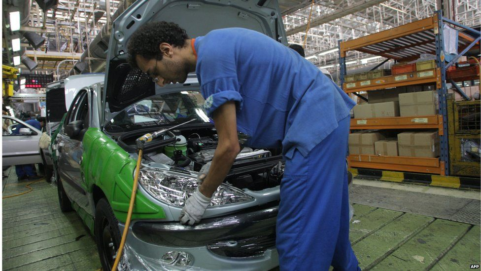 Iranian worker at a car factory west of Tehran (file photo)