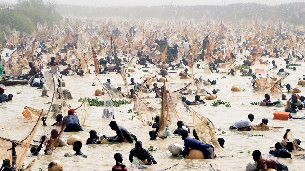Fishermen at the Argungu fishing festival in Kebbi state, Nigeria - Saturday 14 March 2020