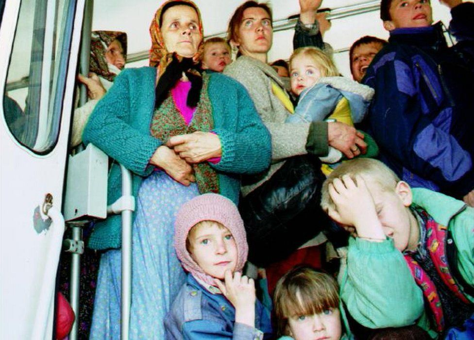 File photo shows refugees from Srebrenica arriving in Tuzla