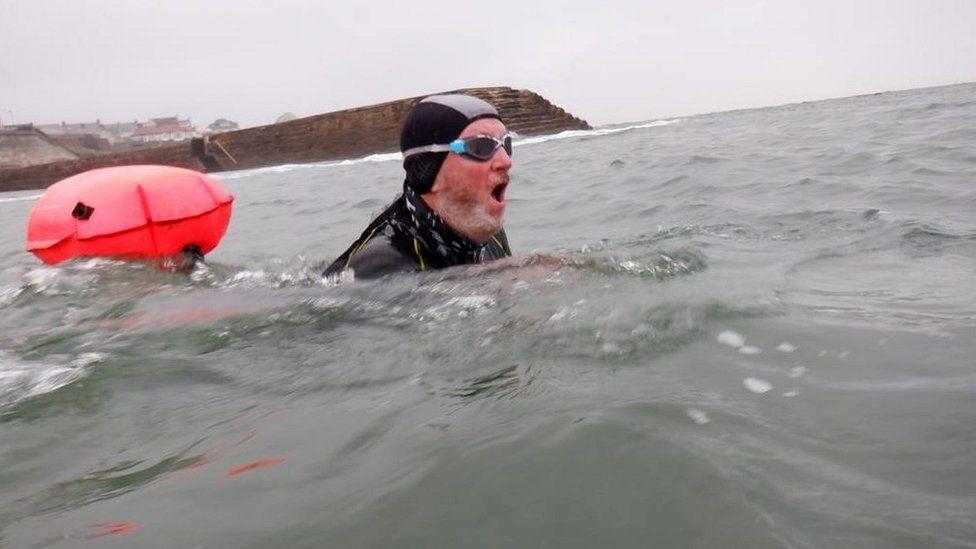 Alan Holmes swimming
