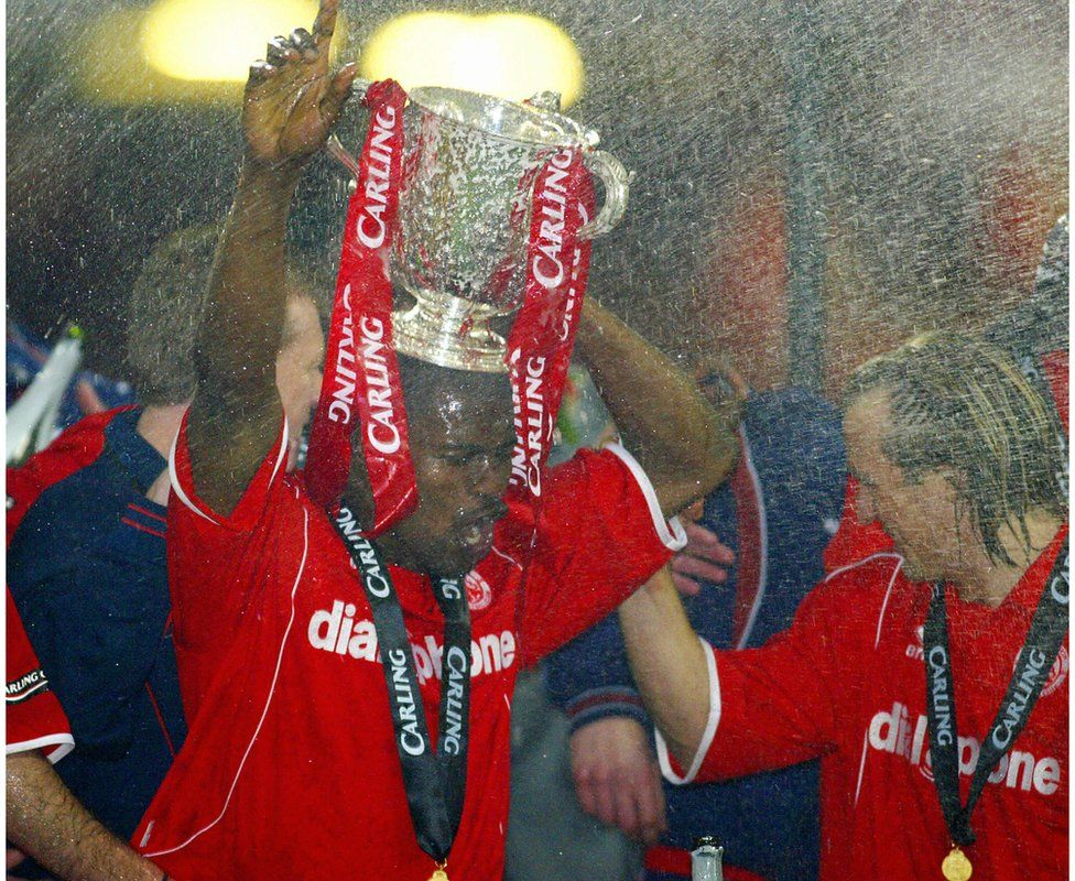George Boateng and Bolo Zenden celebrate winning the Carling Cup Final football match against Bolton 29 February, 2004 in Cardiff
