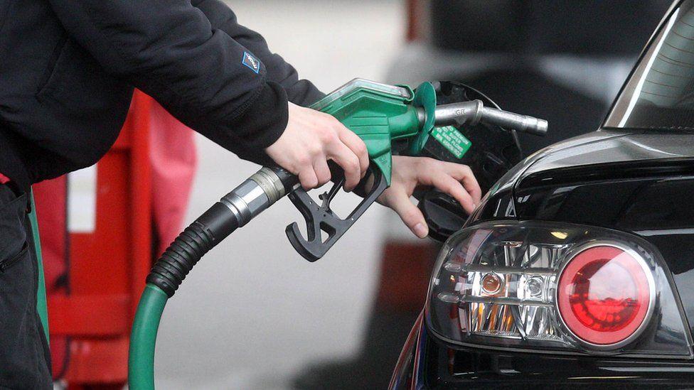 Petrol pump nozzle and a car