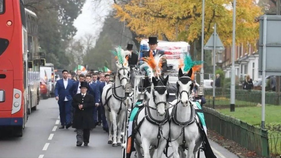 Funeral procession for Joe Rooney