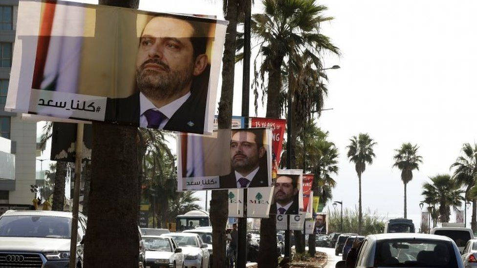 Posters of Lebanese Prime Minister Saad Hariri hang on Beirut streets on 10 November 2017