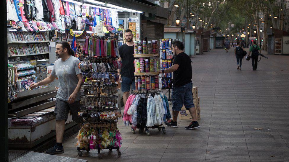 Men opening up a shop on Las Ramblas