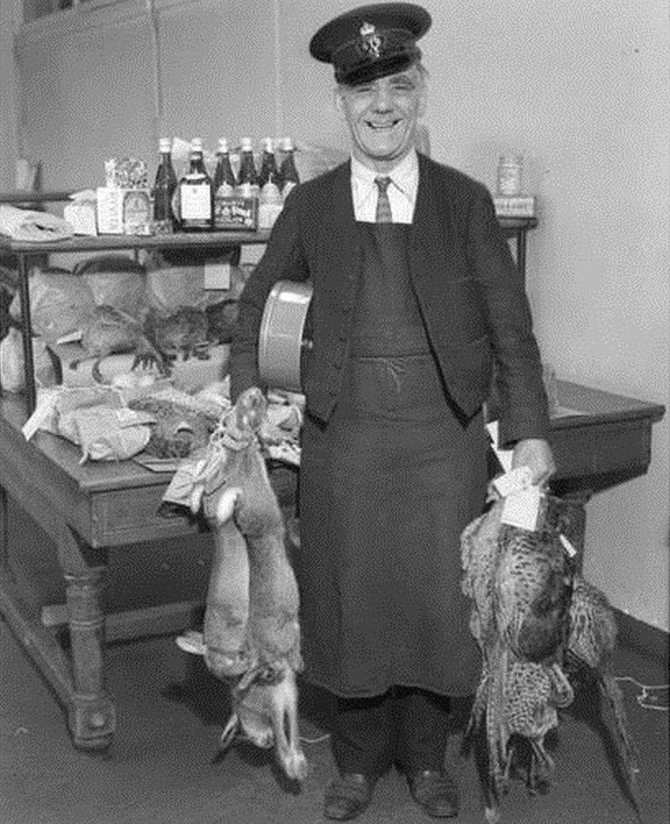Postman with rabbits and pheasants
