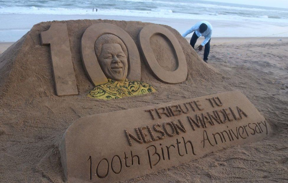 Sand sculpture of former president of South Africa Nelson Mandela is seen at the Bay of Bengal Sea's eastern coast beach as it is creating by Indian sand artist Sudarshan Pattnaik for visitors attraction on the occasion of his 100th birth anniversary at Puri, 65 km away from the eastern Indian state odisha's capital city Bhubaneswar, on July 18, 2018.