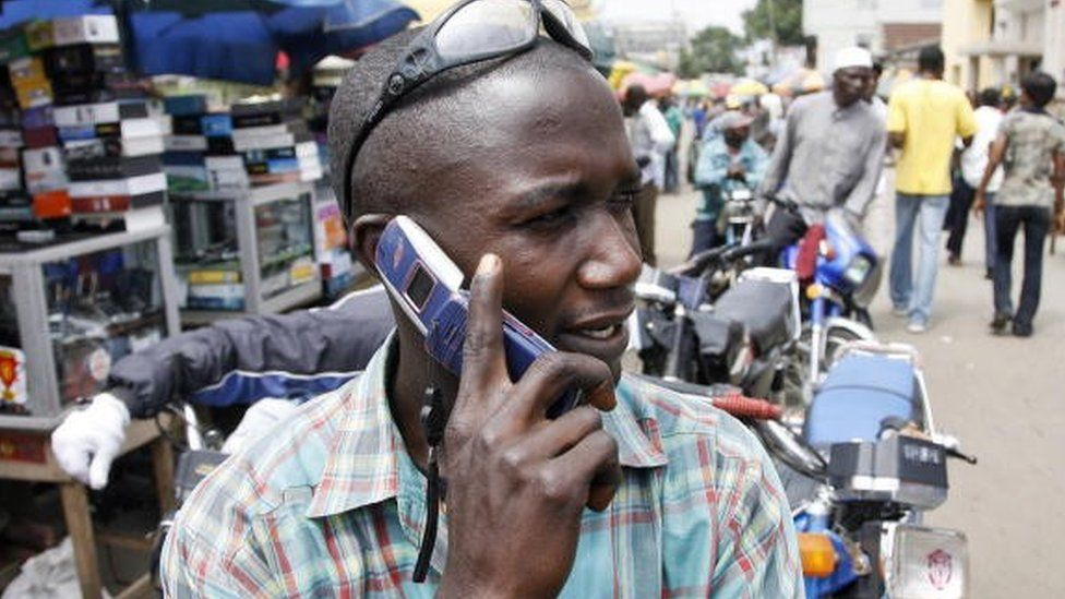 A man on a mobile phone in Nigeria