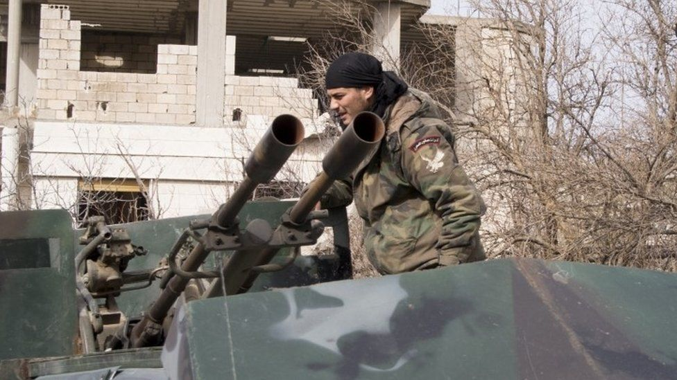 Syrian army soldier in the recently recaptured village of Salma, 22 January 2016
