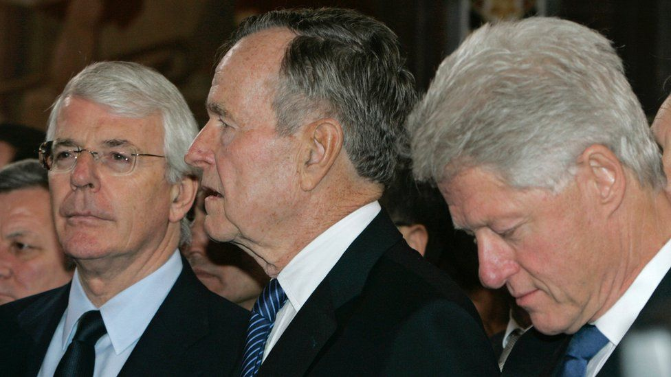 John Major (L), George HW Bush (C) and Bill Clinton at Boris Yeltsin's funeral in April 2007