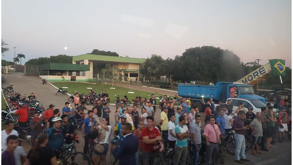 People queuing at a petrol station in Rondonia, Brazil