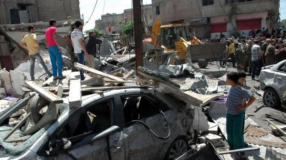 Aftermath of a car bombing in the Abbasiya district of Homs (29 April 2014)