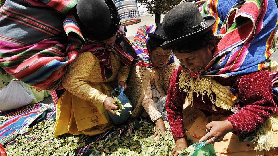 Aymara women chew coca leaves in front of the US embassy to Bolivia in January 2011.