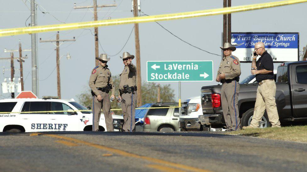 Law enforcement officials gather near First Baptist Church