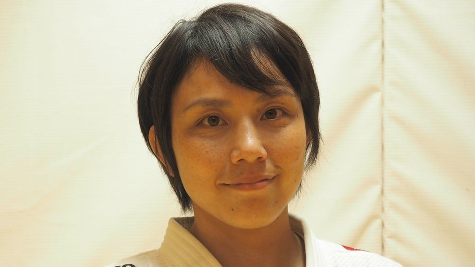 Yuko Fujii posing for a photo during a break in coaching
