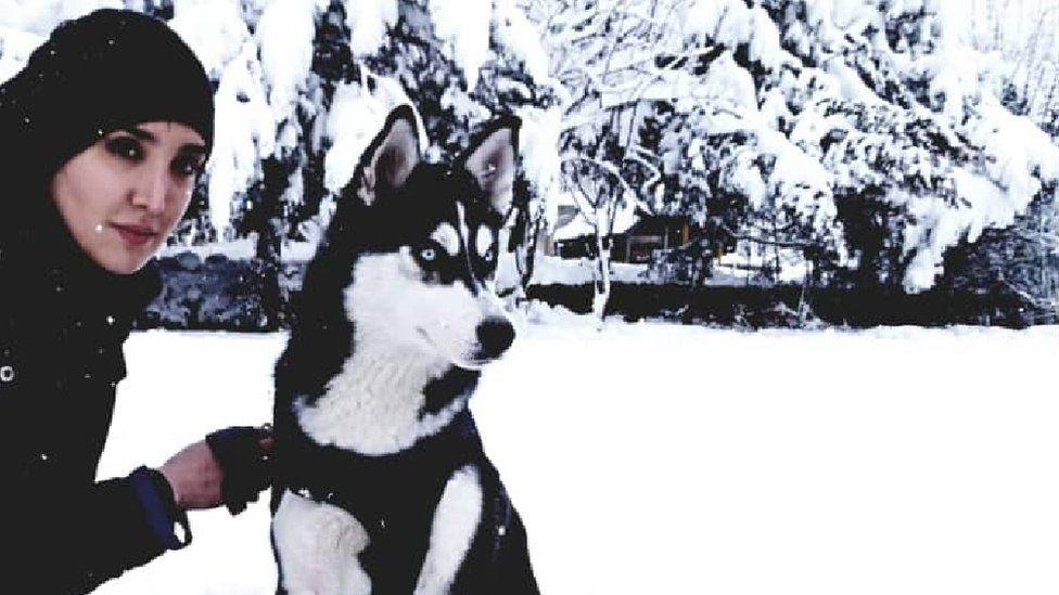 Sahba Barakzai, and her dog Aseman in the snow