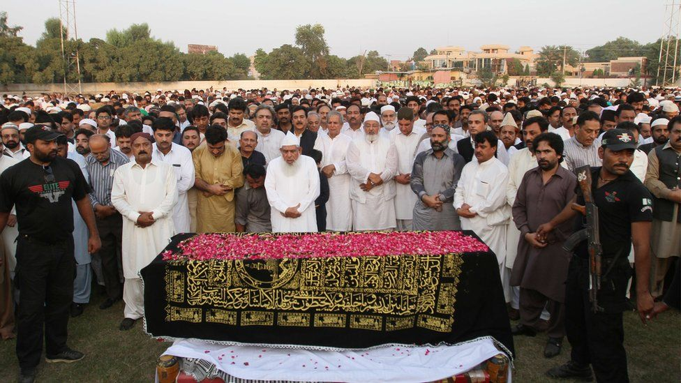 Pakistani politicians, relatives and residents offer funeral prayers for a Pakistani pilgrim, killed in a stampede at the annual hajj