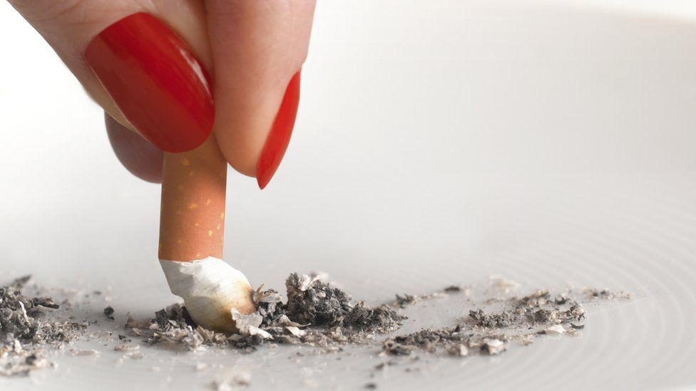 A cigarette being stubbed out