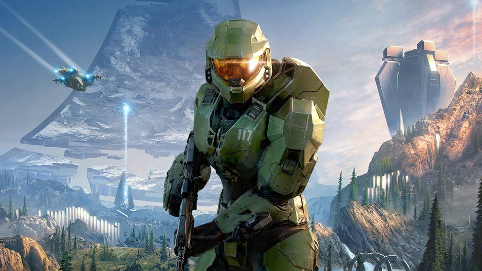 The main character of the Halo series, known as the Master Chief, stands in this promo artwork for the upcoming Halo: Infinite