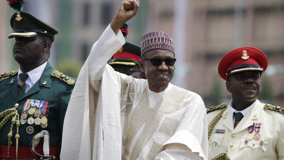 New Nigerian President, Muhammadu Buhari, salutes his supporters during his Inauguration in Abuja, Nigeria, Friday, May 29,