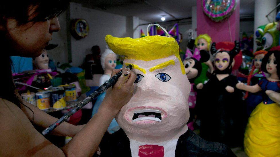 A Trump pinata being painted at a shop in Mexico City - July 2015