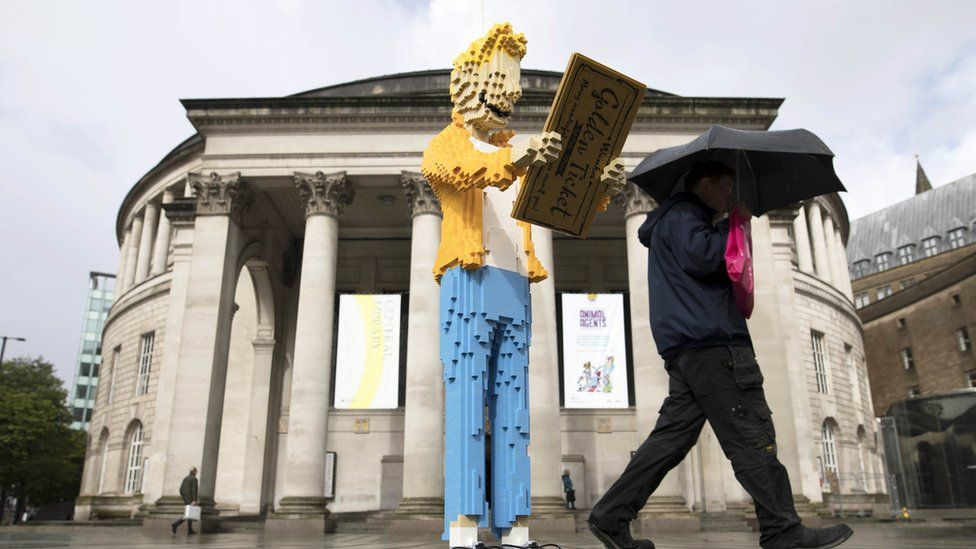 A Lego version of Charlie outside Manchester Central Library