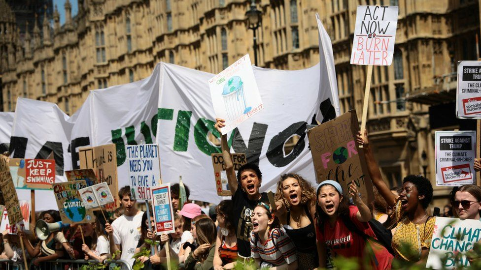 Students take part in a climate rally in Parliament Square