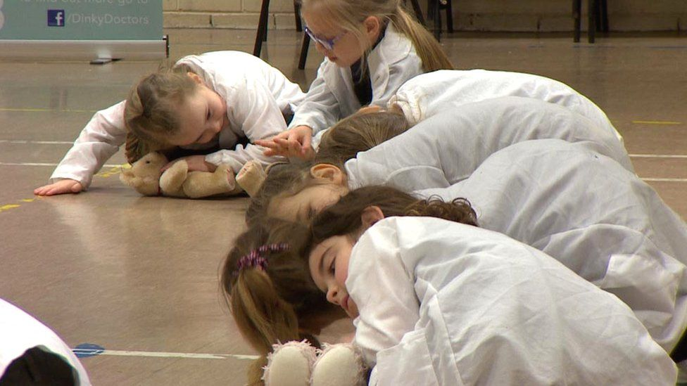 Children learning with teddy bears