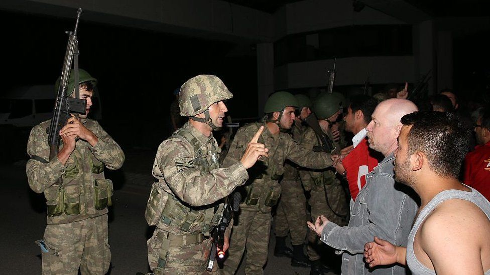 A group of soldiers try to storm into state run Turkish Radio and Television Corporation (TRT) in Ankara, Turkey on July 16, 2016