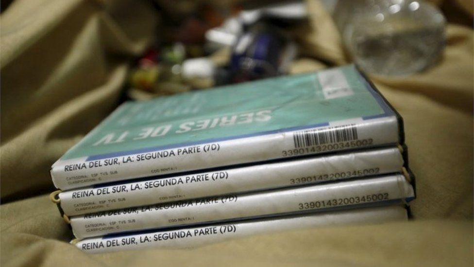 A stack of Reina del Sur DVDs in the house in Los Mochis where Guzman was hiding