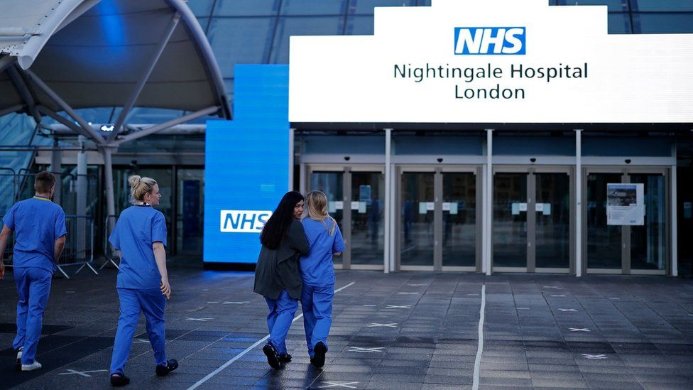 Staff outside NHS Nightingale in London