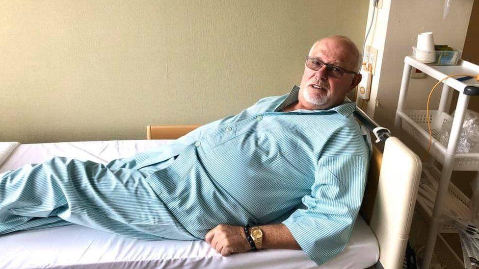 David Abel on a hospital bed