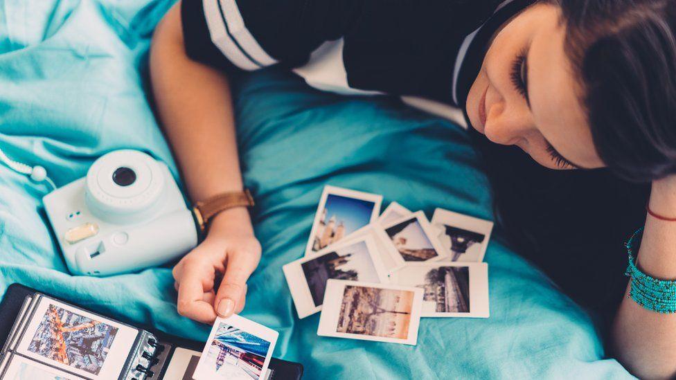 Woman looking at photographs