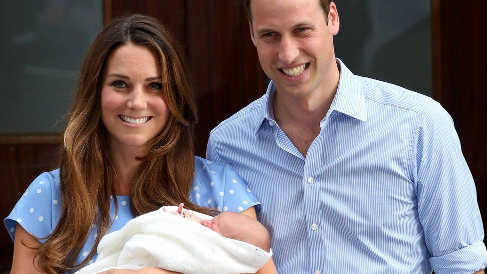 George with his parents outside hospital