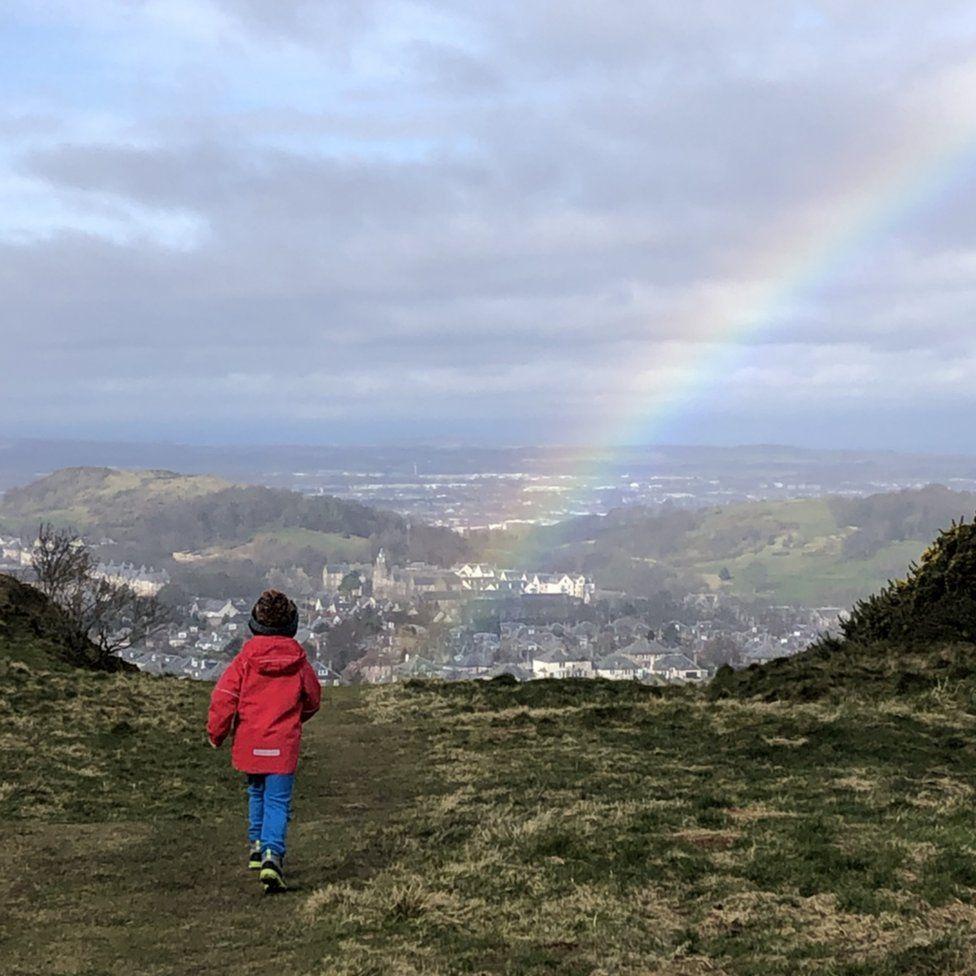 Boy and rainbow