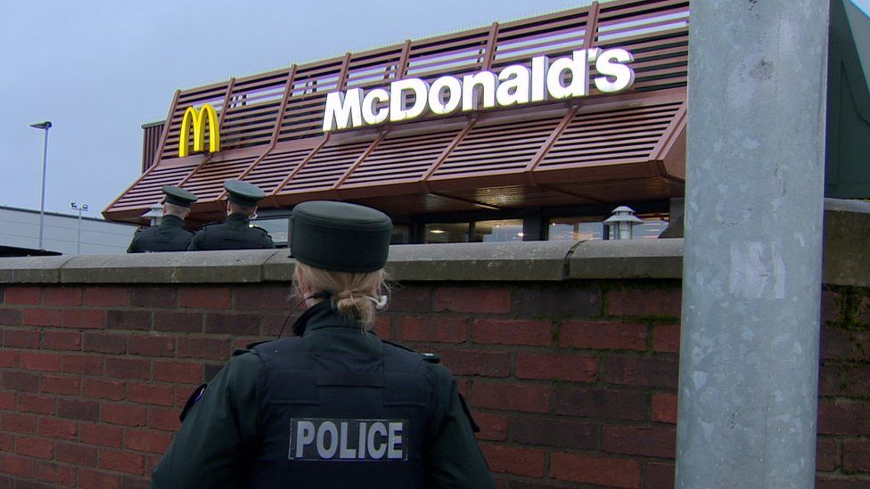 Police officers at McDonalds on Glenmachan Street in Belfast