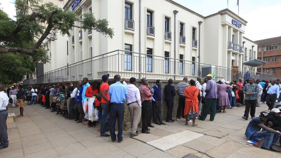 People queuing at a bank in the capital, Harare