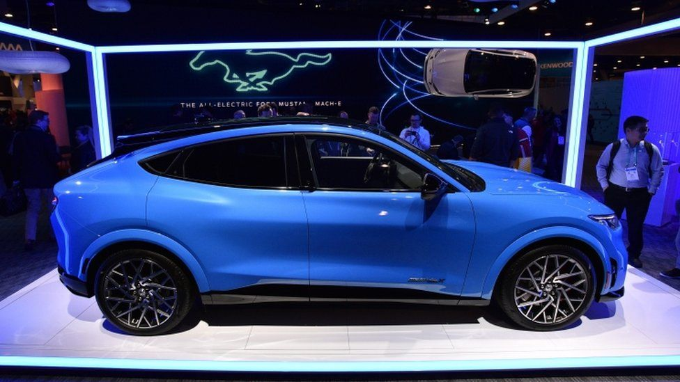 A blue Ford Mustang Mach E GT electric car