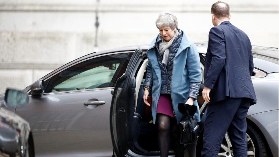 Theresa May getting out of car