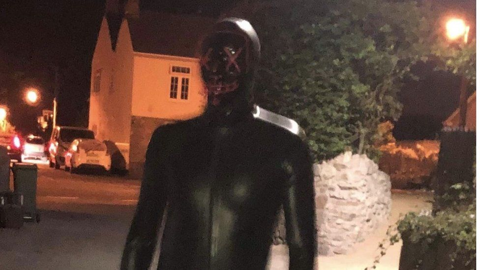 Man in gimp outfit