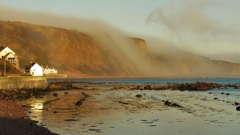 Fog rolls off cliff