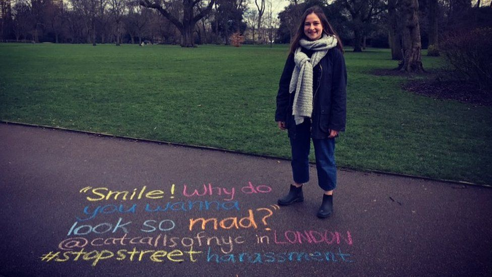Sophie Sandberg standing next to a catcall written out on the ground
