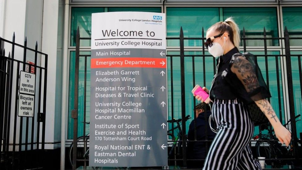 Woman walking past UCH