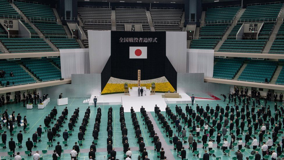 Image shows a memorial event in Tokyo