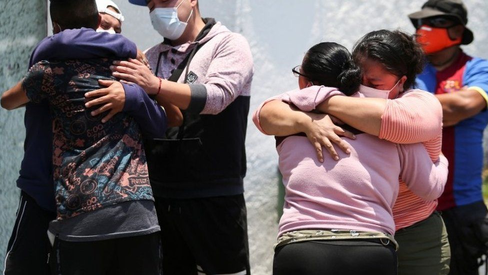 """Relatives of the victims react outside the Prosecutor""""s Office in Iztapalapa neighbourhood, after an overpass of the metro partially collapsed with train cars on it in Mexico City"""