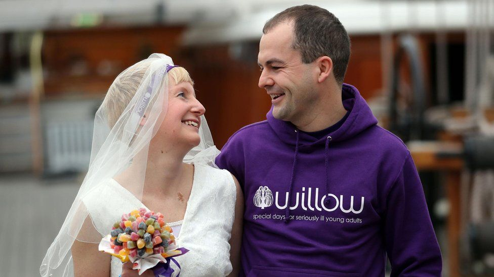 Breast cancer survivor Jackie Scully and her new husband Duncan Sloan on the The Cutty Sark where they got married before taking part in the 2017 Virgin Money London Marathon