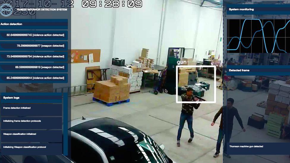Screenshot of security camera showing gunman