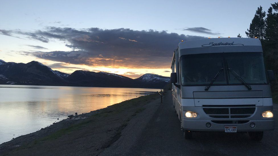 Alyssa Hulme's rented RV parked next to a lake.